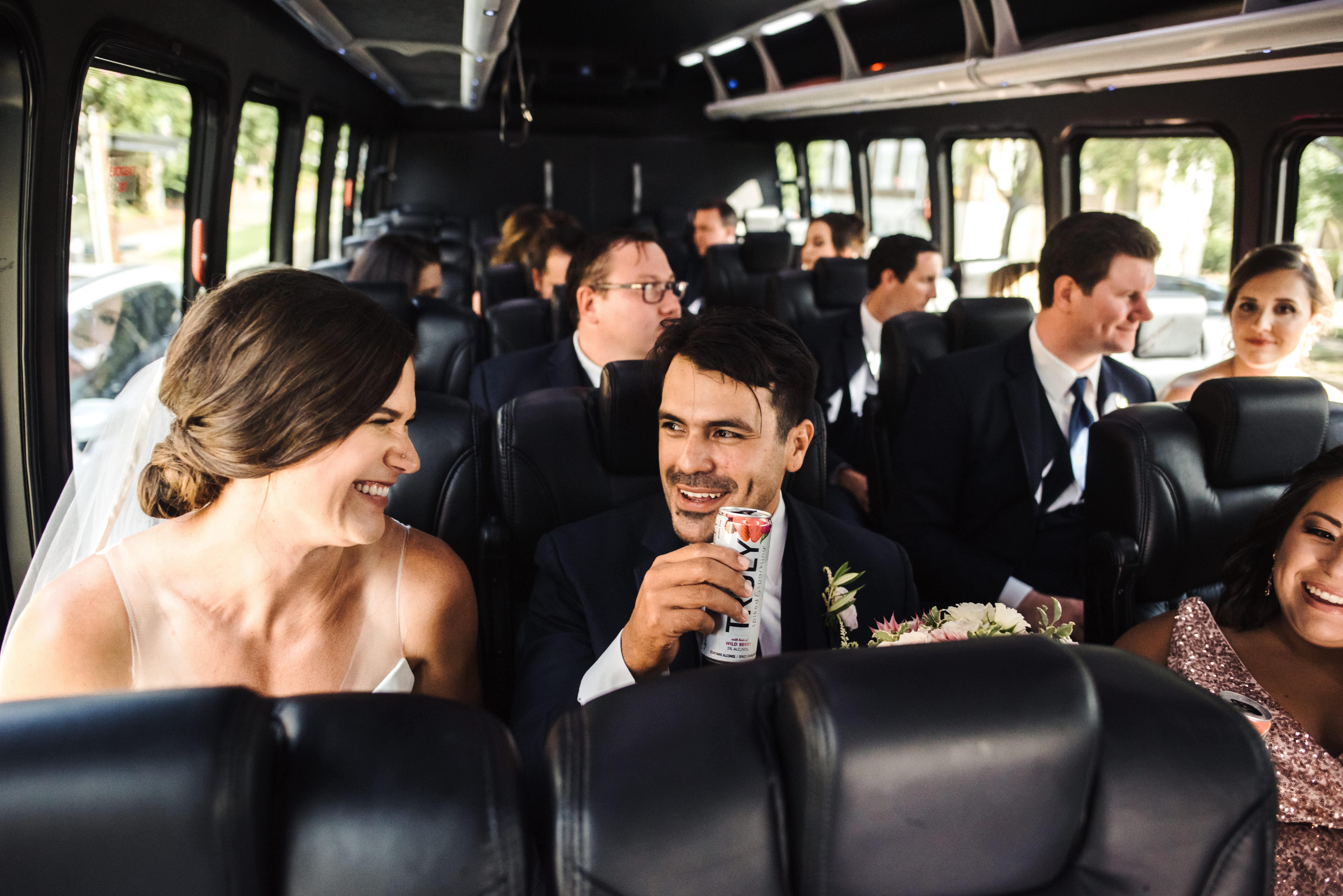 Wedding Couple Enjoying Limo Ride